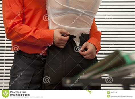 Colleague Are Catched In The Act Stock Image - Image of