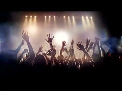 Footage of a crowd partying, dancing slow motion at a